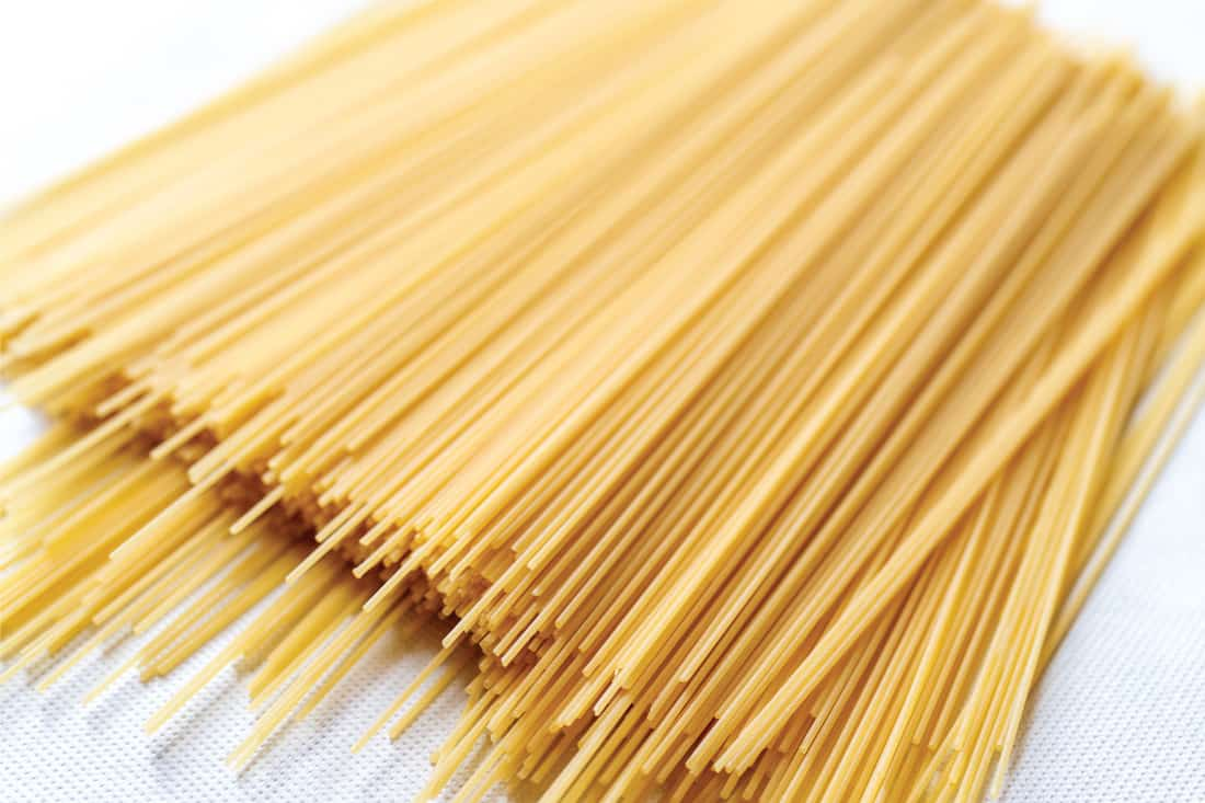 photo of raw italian spaghetti pasta