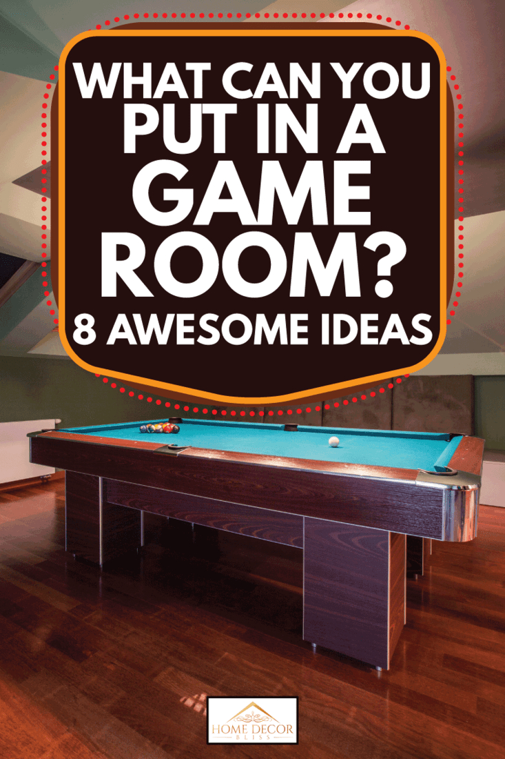 Pool table in a game room with brown wooden floor and pendant lights, What Can You Put In A Game Room? [8 Awesome Ideas]