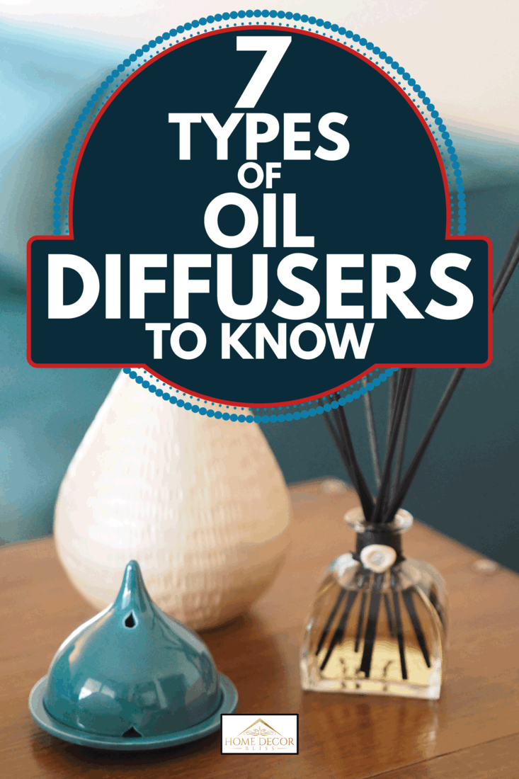reed and ceramic oil diffuser on top pf a brown nightstand with lamp. 7 Types Of Oil Diffusers To Know
