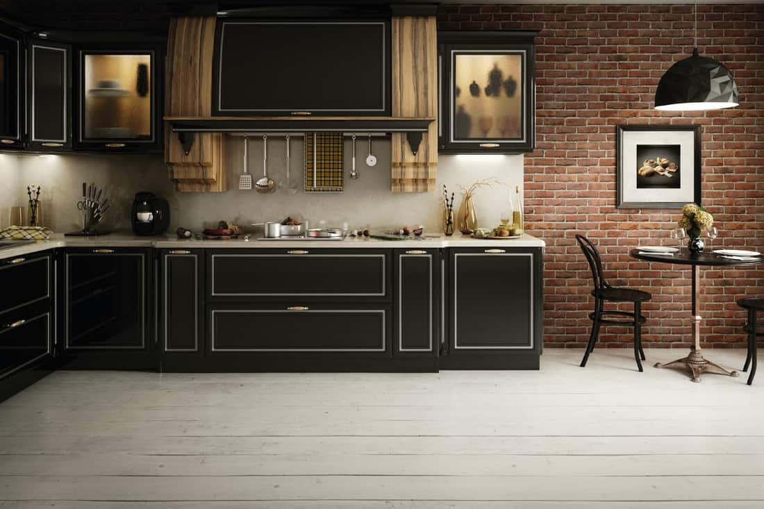 Stylish and luxurious domestic kitchen with grey floor and black cabinets