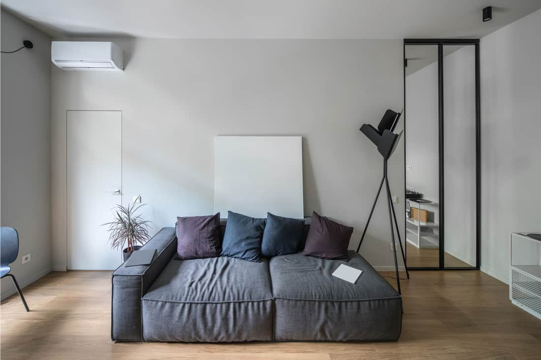 white walled bedroom with Purple And Navy Throw Pillows To Your Charcoal Grey Couch