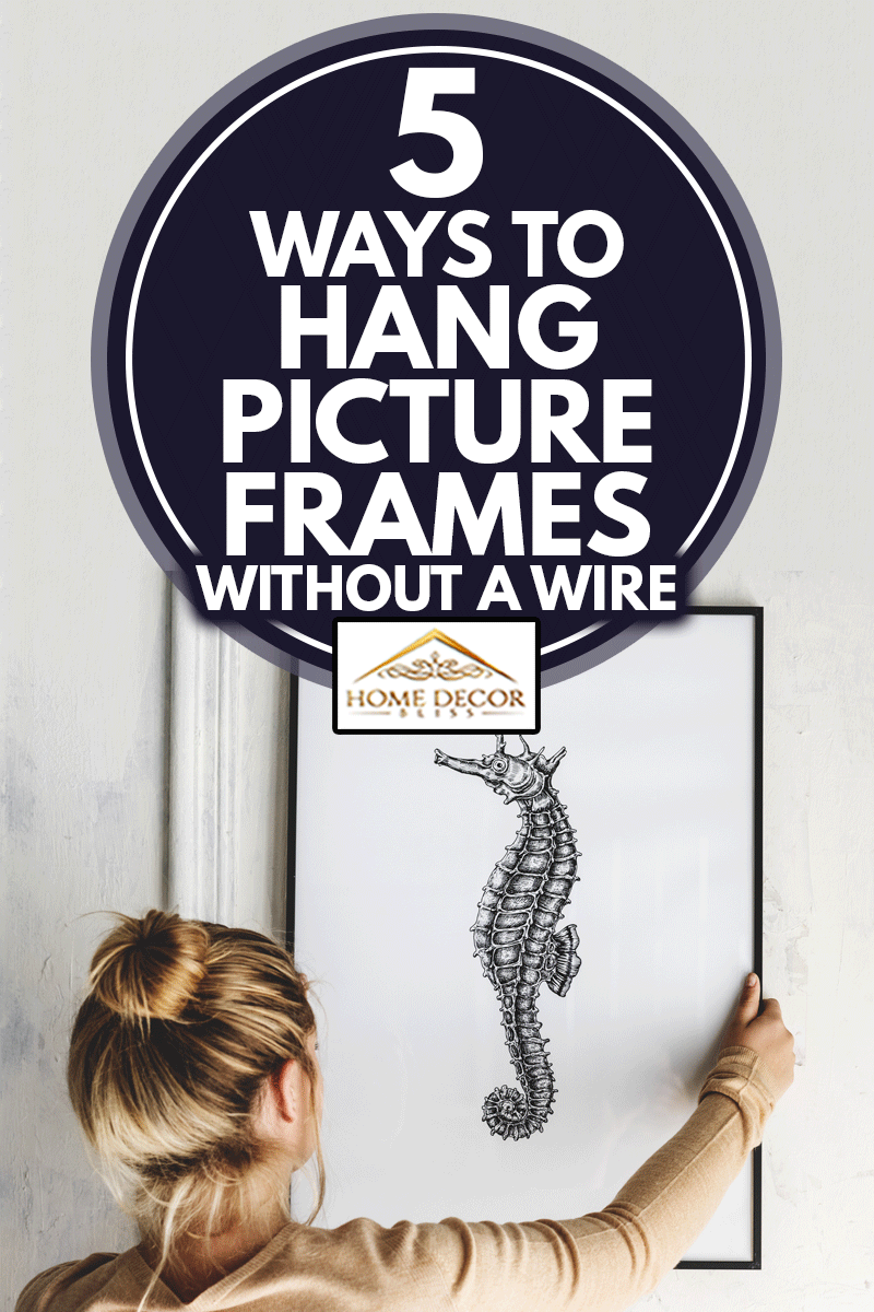 Photo of hand drawing seahorse is hanging on the wall, 5 Ways To Hang Picture Frames Without Wire