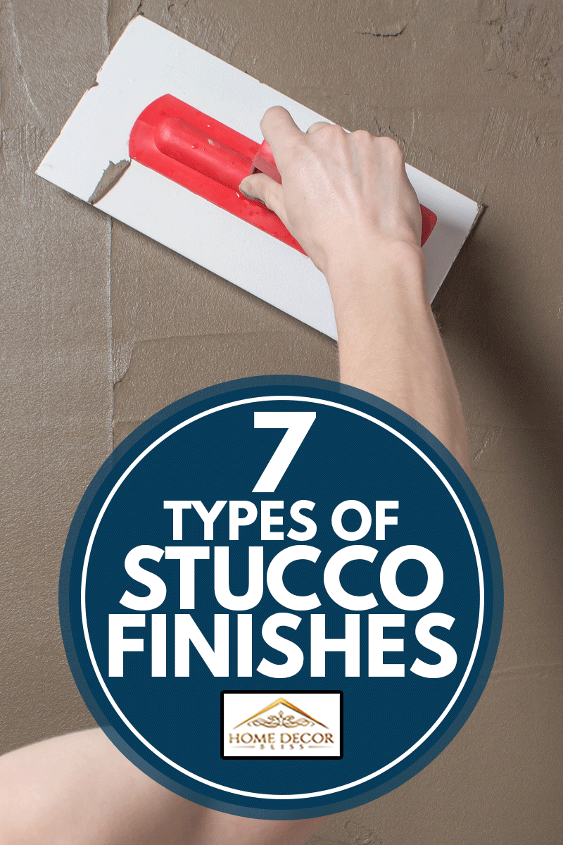 Hand holding a spatula with construction mix.Applying putty or tile glue to the wall, 7 Types Of Stucco Finishes