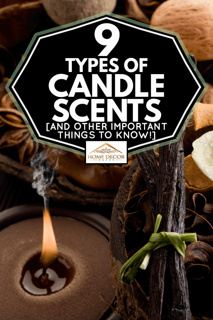 A Woody scented candle with a flower on top and black leaf, 9 Types Of Candle Scents [And Other Important Things To Know!]