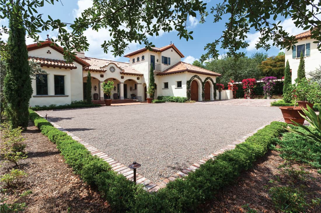 A beautiful estate home with French architecture. Edge Your Gravel With Vertical Brick
