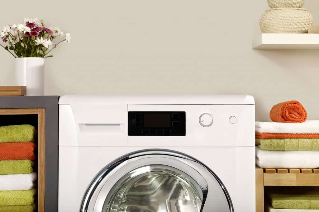 A detailed photo of a washing machine and towels on the side