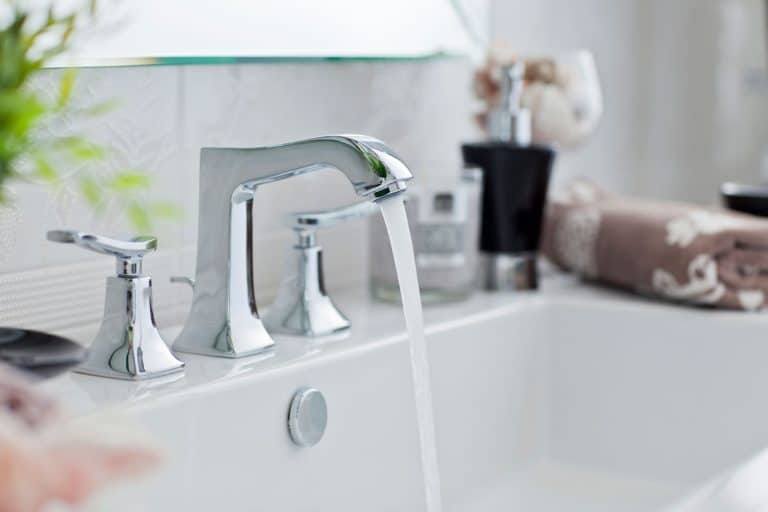 A faucet turn on inside a modern bathroom, Is Bathroom Sink Water Safe To Drink?