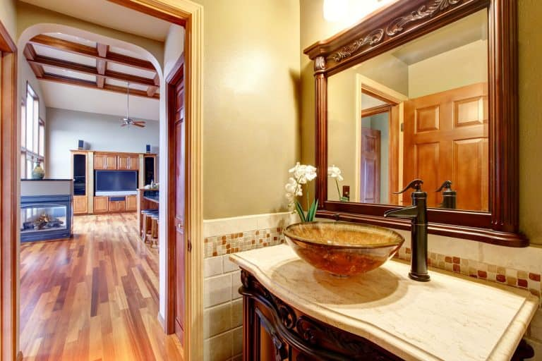 A gorgeous rustic interior of a farmhouse themed bathroom, How Big Should A Vessel Sink Be?