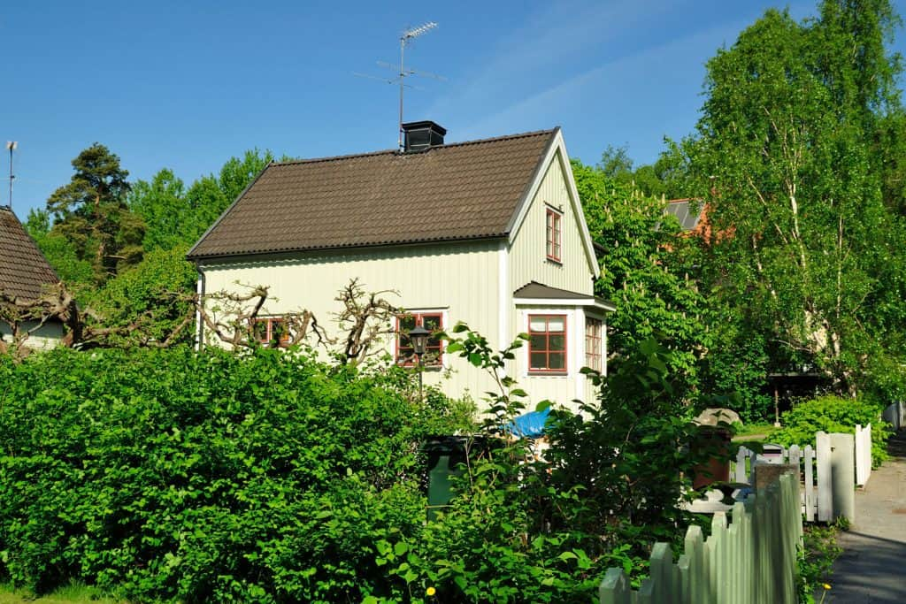 A gorgeous Swedish house with asphalt shingle roofing