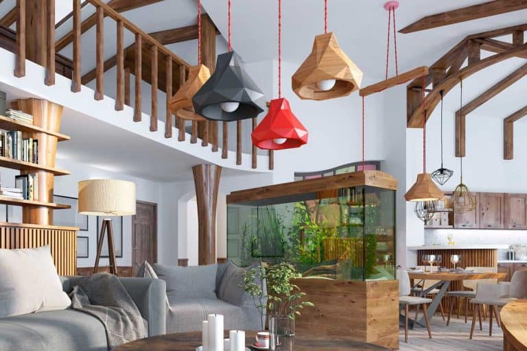 A loft style rustic living room with aquarium and stylized shelving for books, 11 Awesome Rustic Ceiling Lighting Ideas