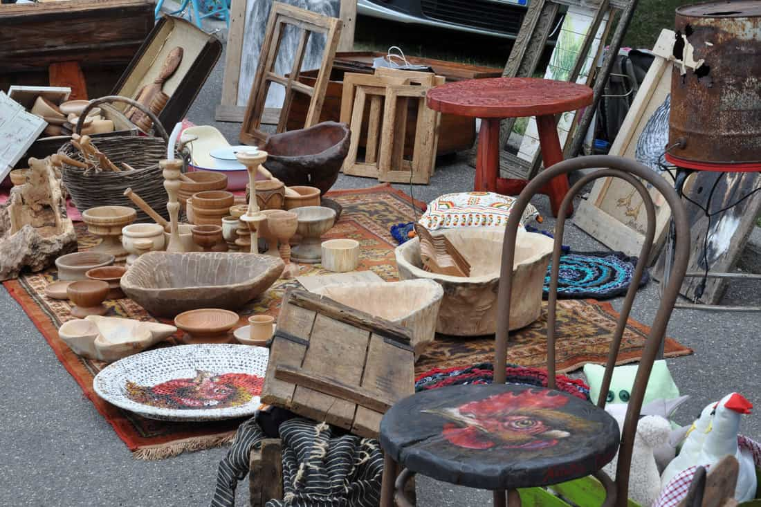 A garage sale of used furniture items