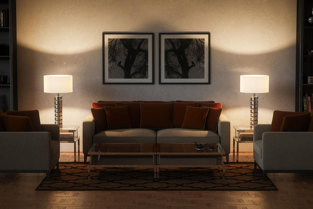 A modern living room with lamp and end tables