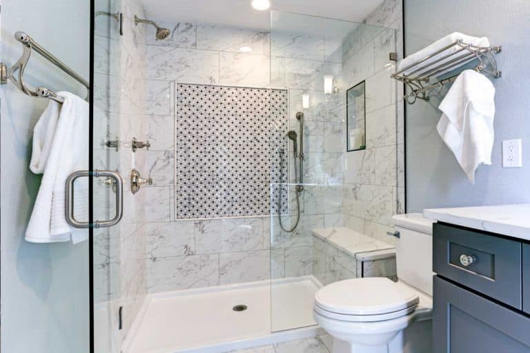 A new blue bathroom design with marble shower surround and mosaic accent tiles, Is A Shower Base Better Than Tiles?