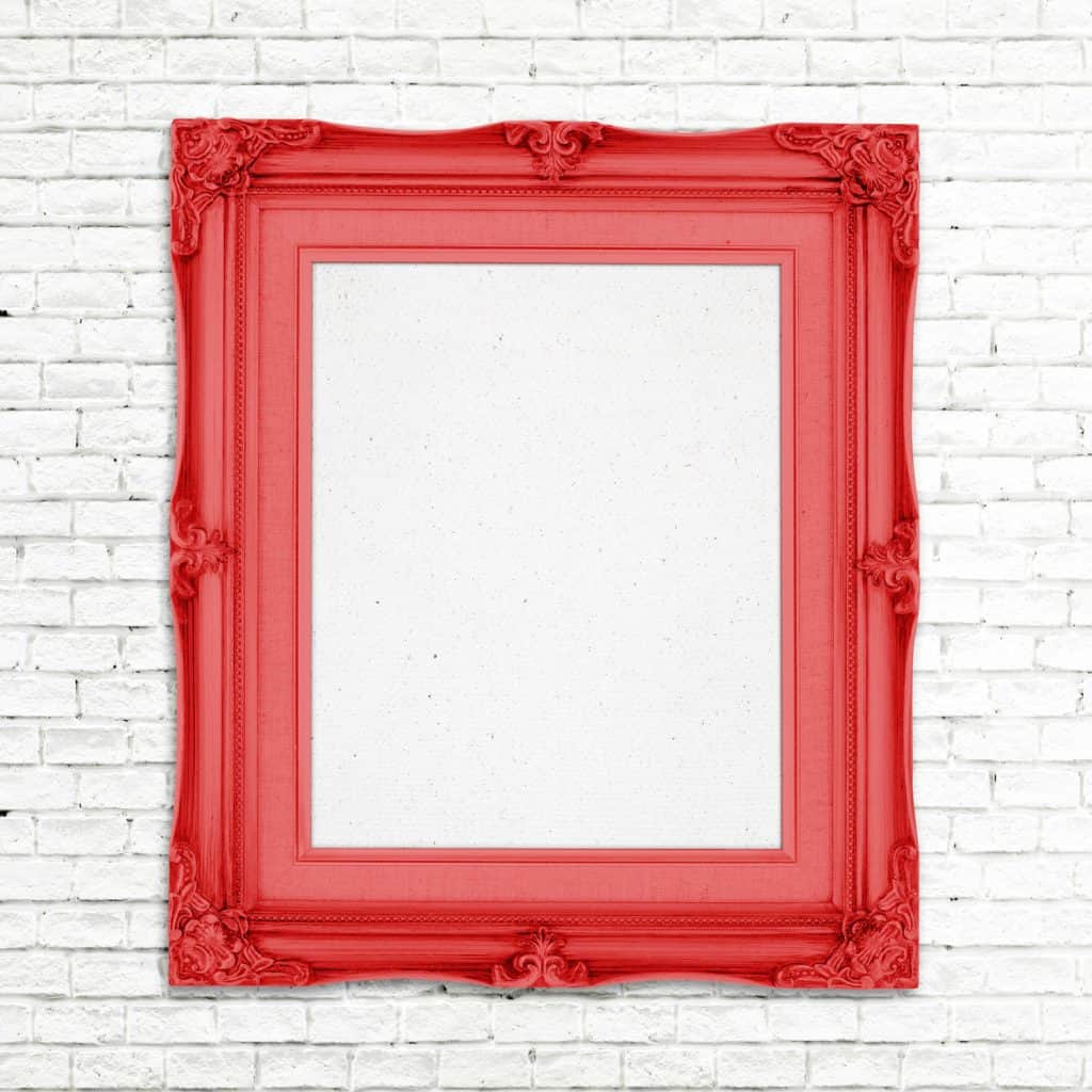 A red frame nailed on the wall