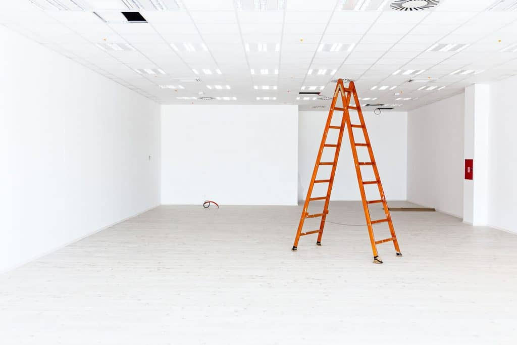 A room currently undergoing construction and a ladder inside
