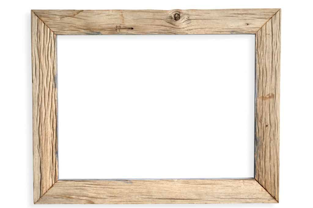 A wooden picture frame on a white background