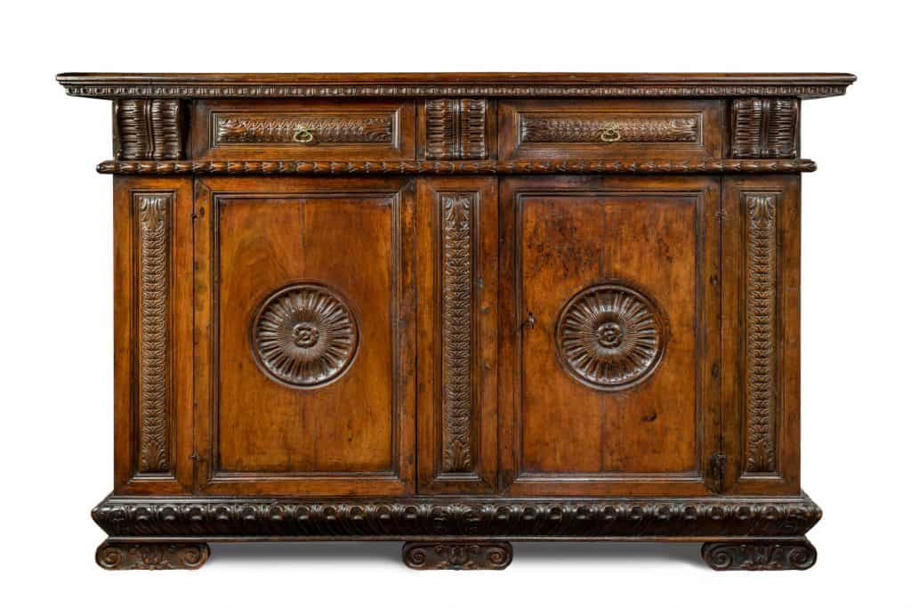 An old vintage Italian wooden carved sideboard buffet