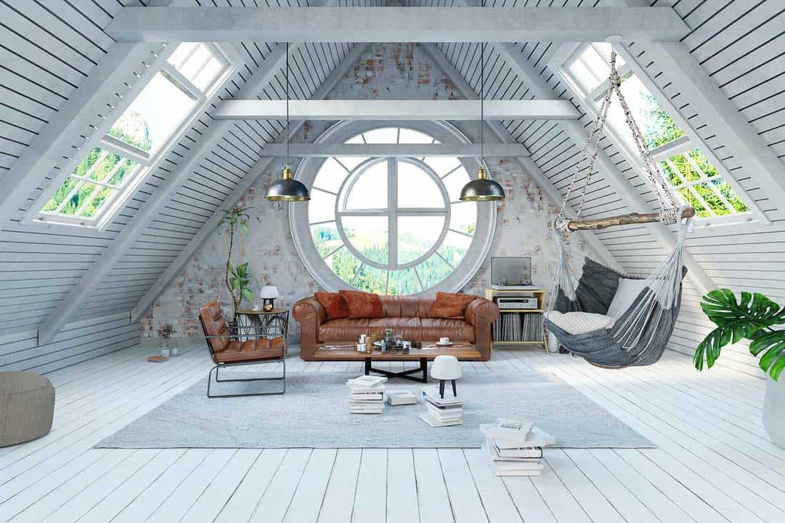 Attic living room interior of a white wooden house
