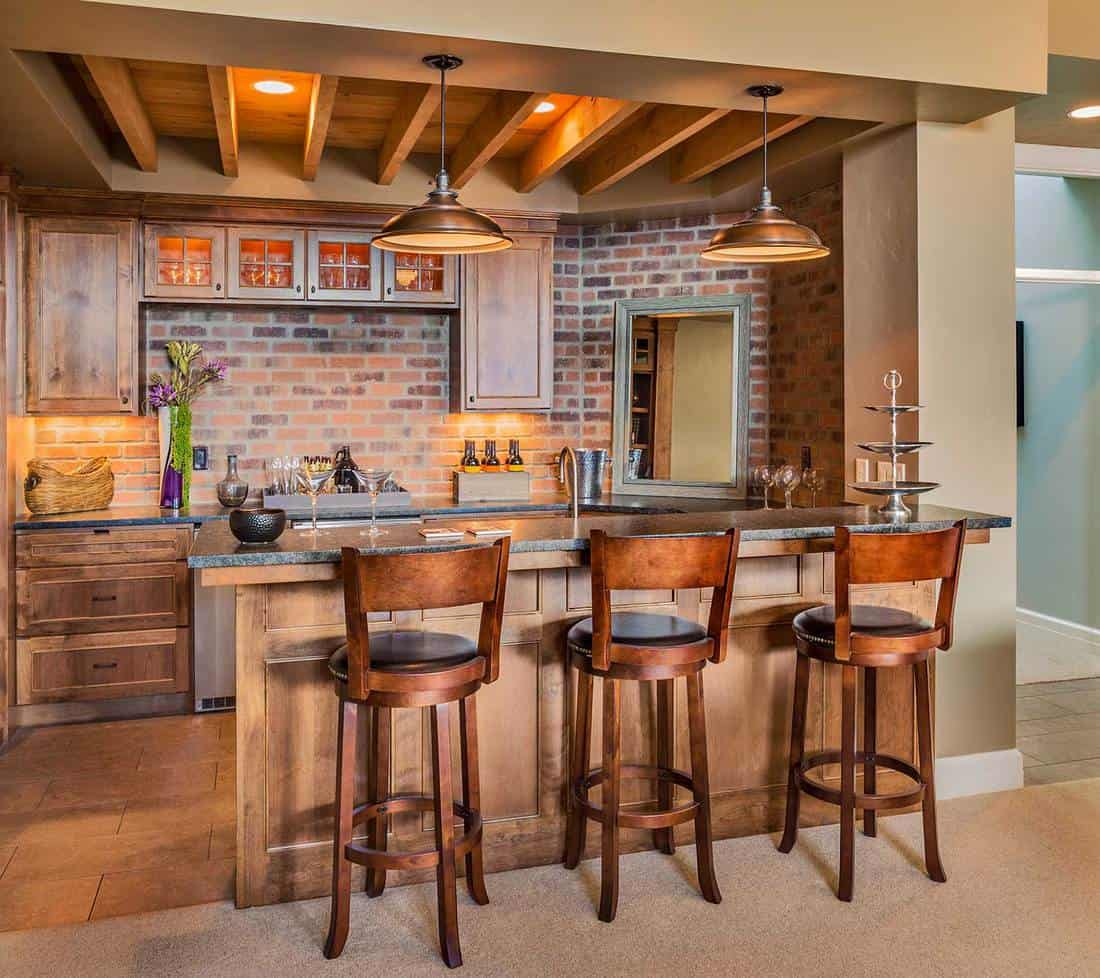 Bar complete with chairs, wine glasses, beer and new cabinets