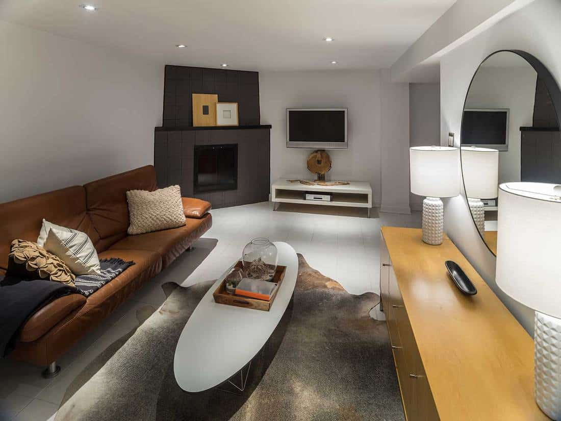 Basement living room interior with modern furniture and entertainment