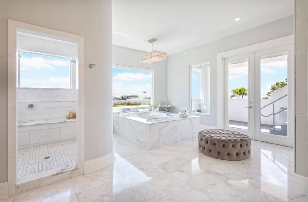 Beautiful Master Bathroom Interior with free standing bath tub surround by marble floor