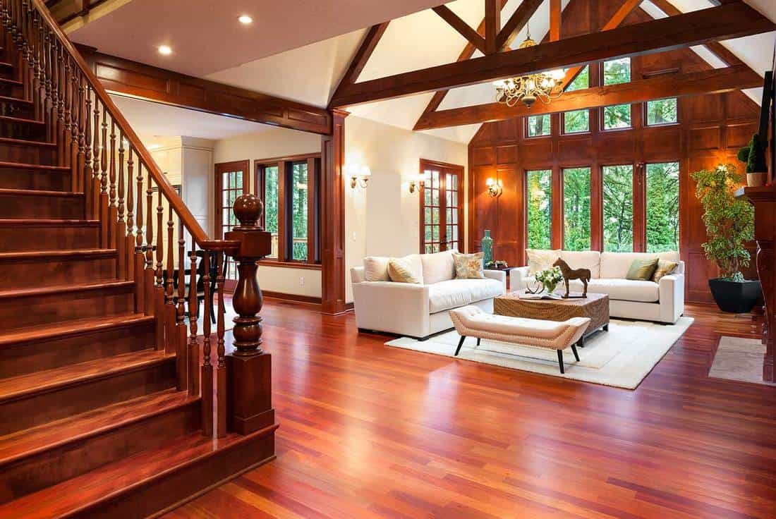 Beautiful large living room interior with hardwood floors and fireplace in new luxury home