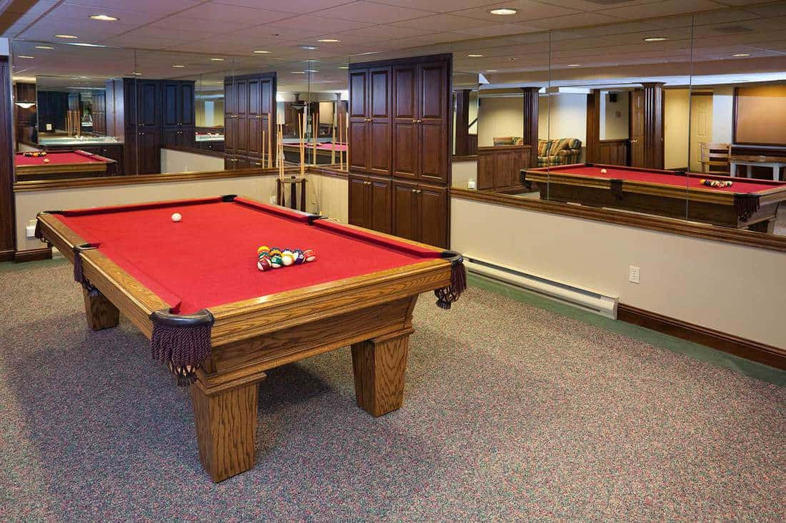 Billiards room with mirrored walls