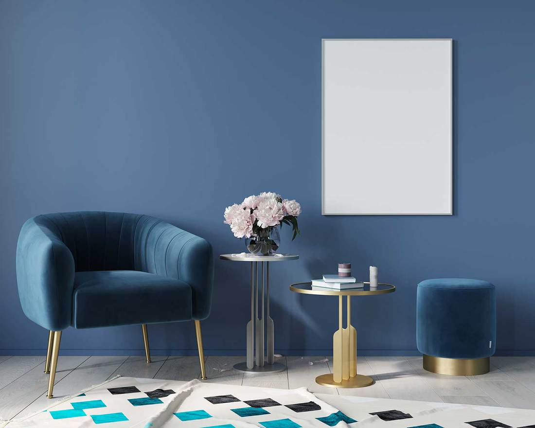 Blue interior in art deco style with armchair, poster, metal tables with marble countertop