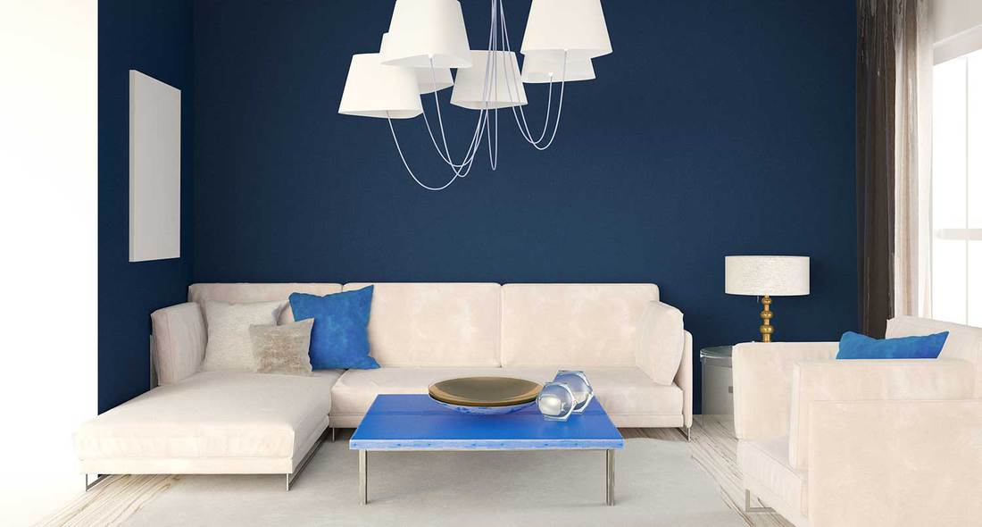 Blue wall in modern living room interior with white leather sofa