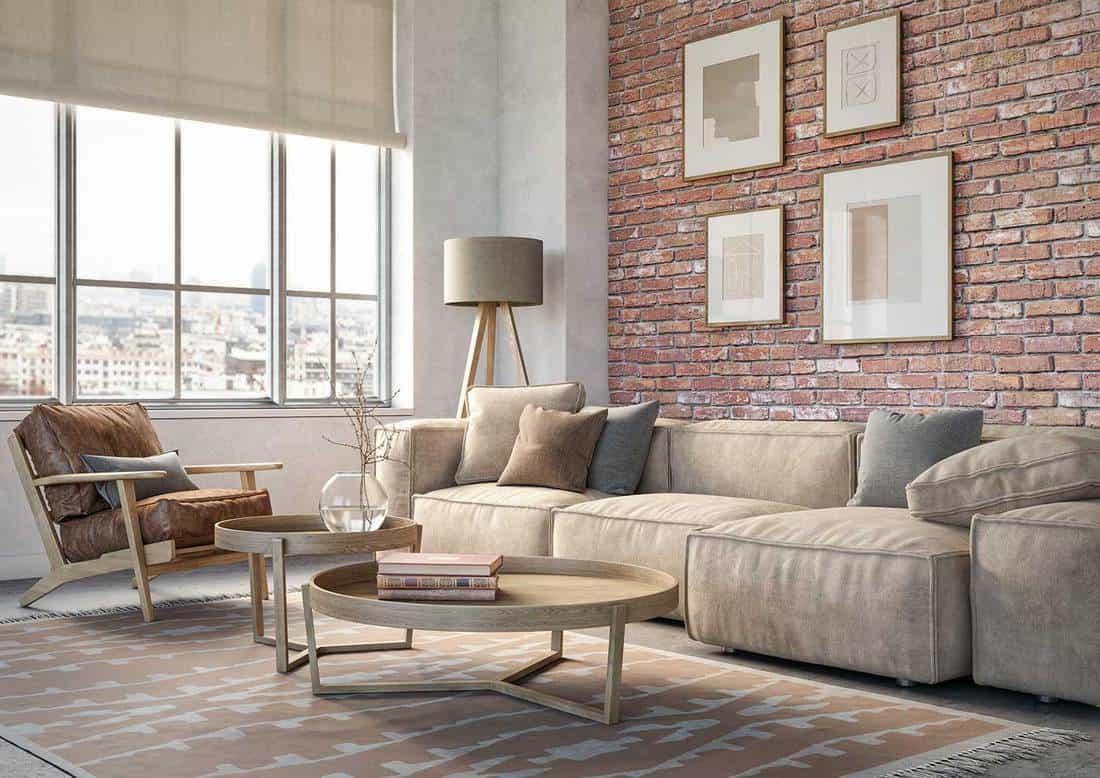 Bohemian living room interior beige sofa, wooden furniture and brick wall