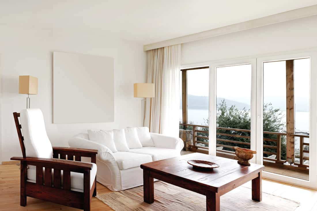 Brightly decorated chic modern house with sea view. White With Wood Accents