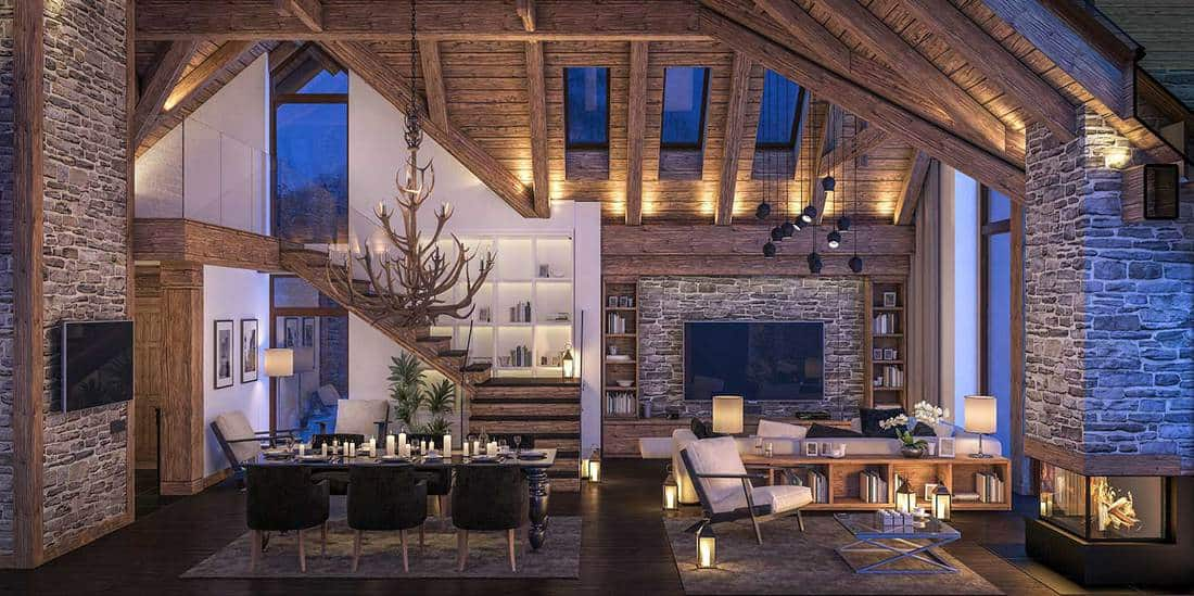 Cozy living room on cold winter night in the mountains, evening interior of chalet decorated with candles, fireplace fills the room with warmth