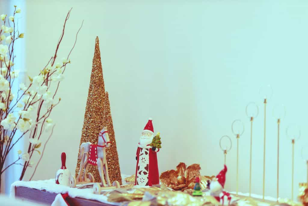 Decorative Christmas figurines on a table with other Christmas related figurines