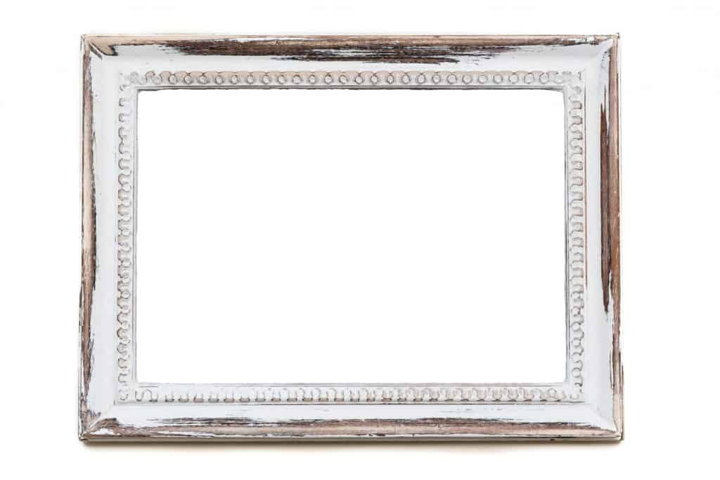 Distressed white painted picture frame. Weathered white timber.