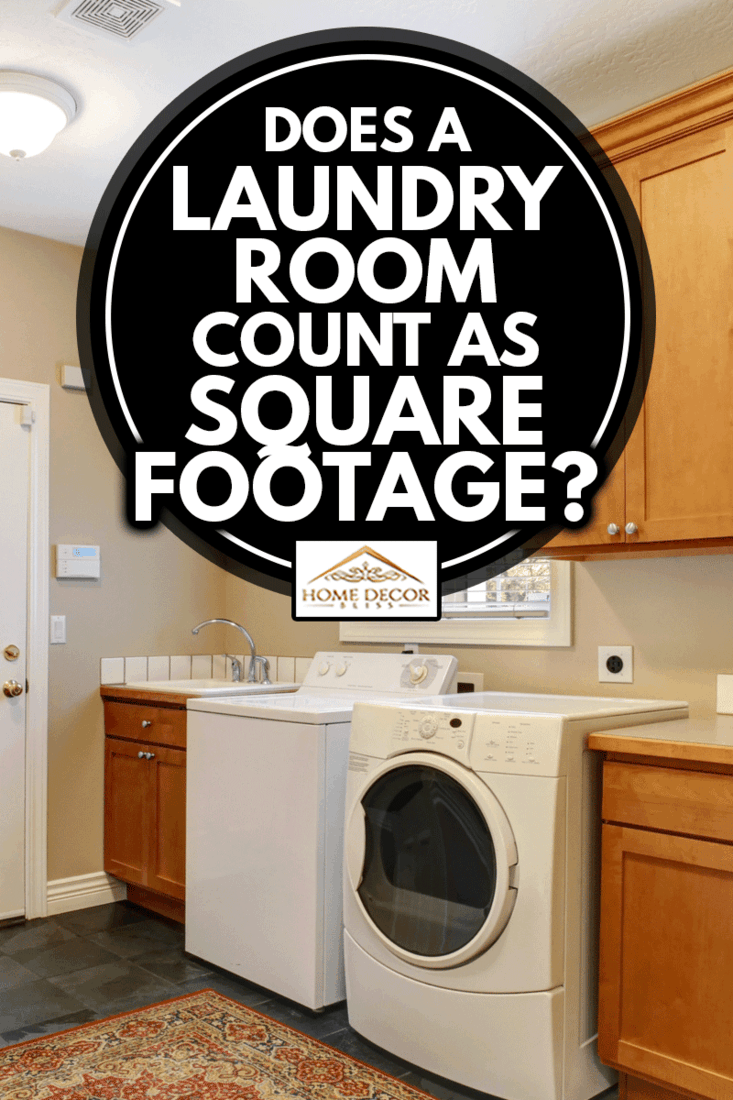 Spacious laundry room with tile floor and rug. Wooden cabinets with white appliannces, Does A Laundry Room Count As Square Footage?