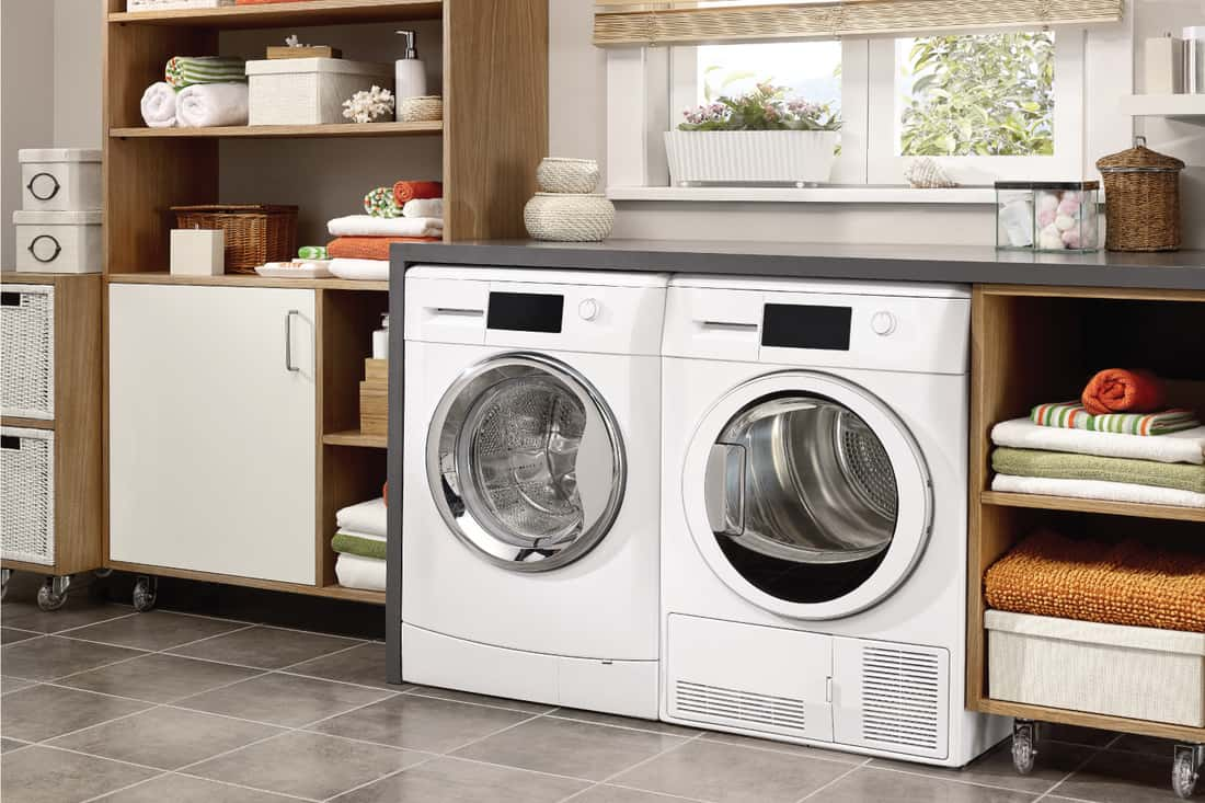 Domestic laundry room with washing machine and dryer. open concept laundry cabinet