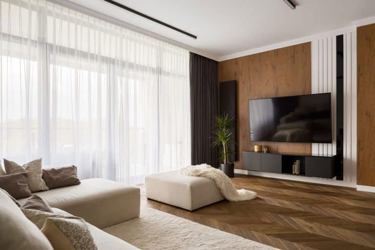 How High To Mount A TV In The Living Room, Elegant designed living room with window wall, big television screen and wooden elements