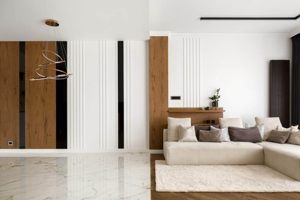 Elegant living room with wooden and marble floor and stylish decorated wall