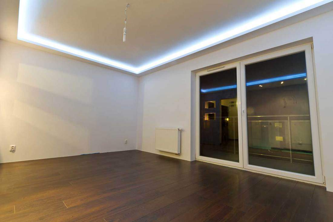 Empty room of a modern apartment with parquet floor