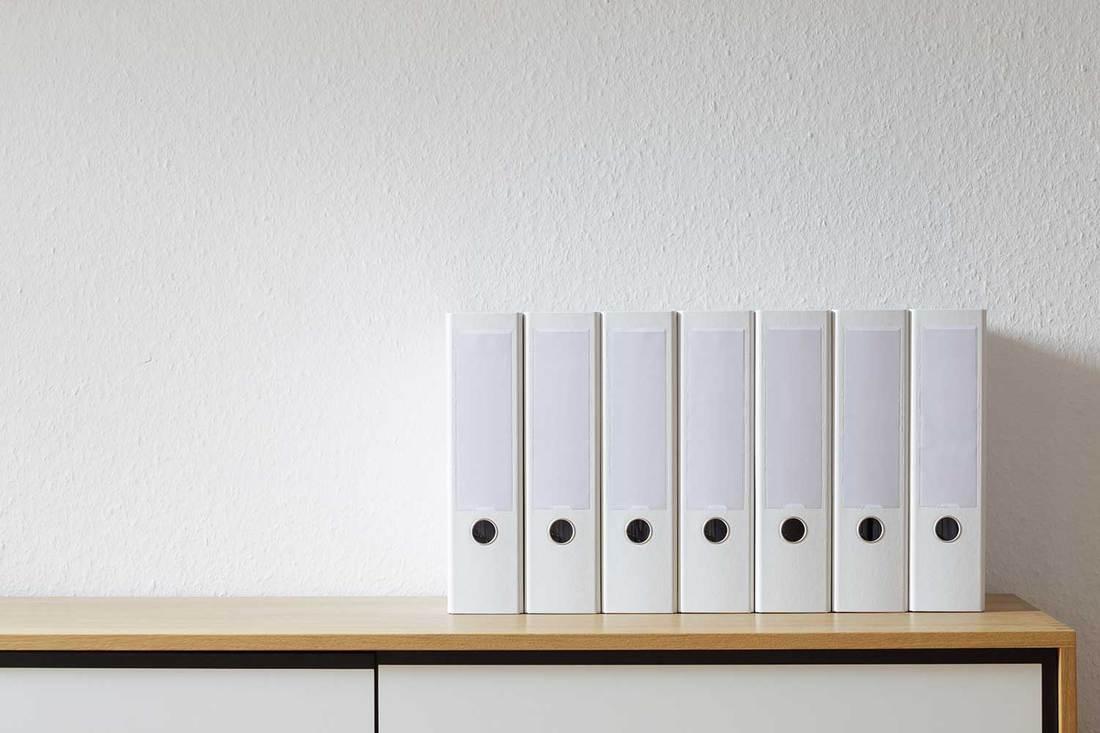 File folder on modern sideboard in bright room