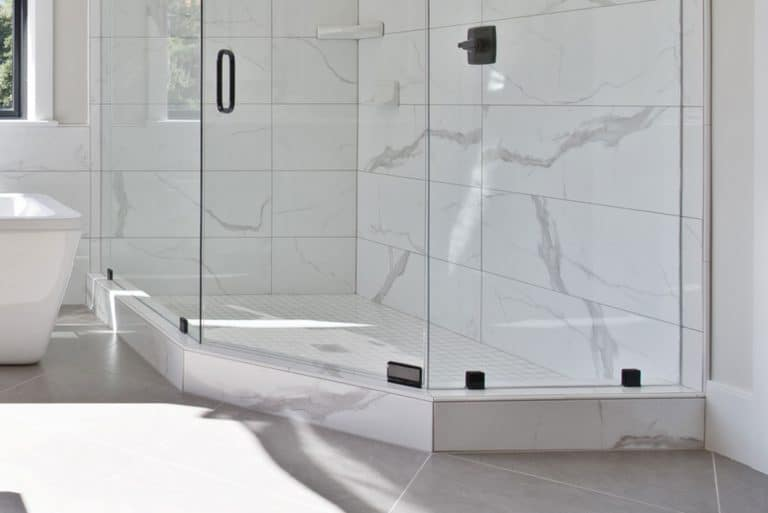 Shower glass with shower base and a marble tile in wall, 12 Types of Shower Bases and Pans