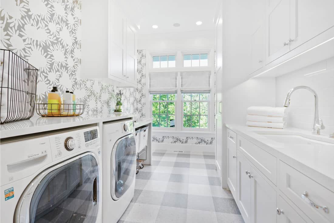 Gingham pattern and white cabinets and countertops. Accent Wall of Wallpaper In Your White Laundry Room