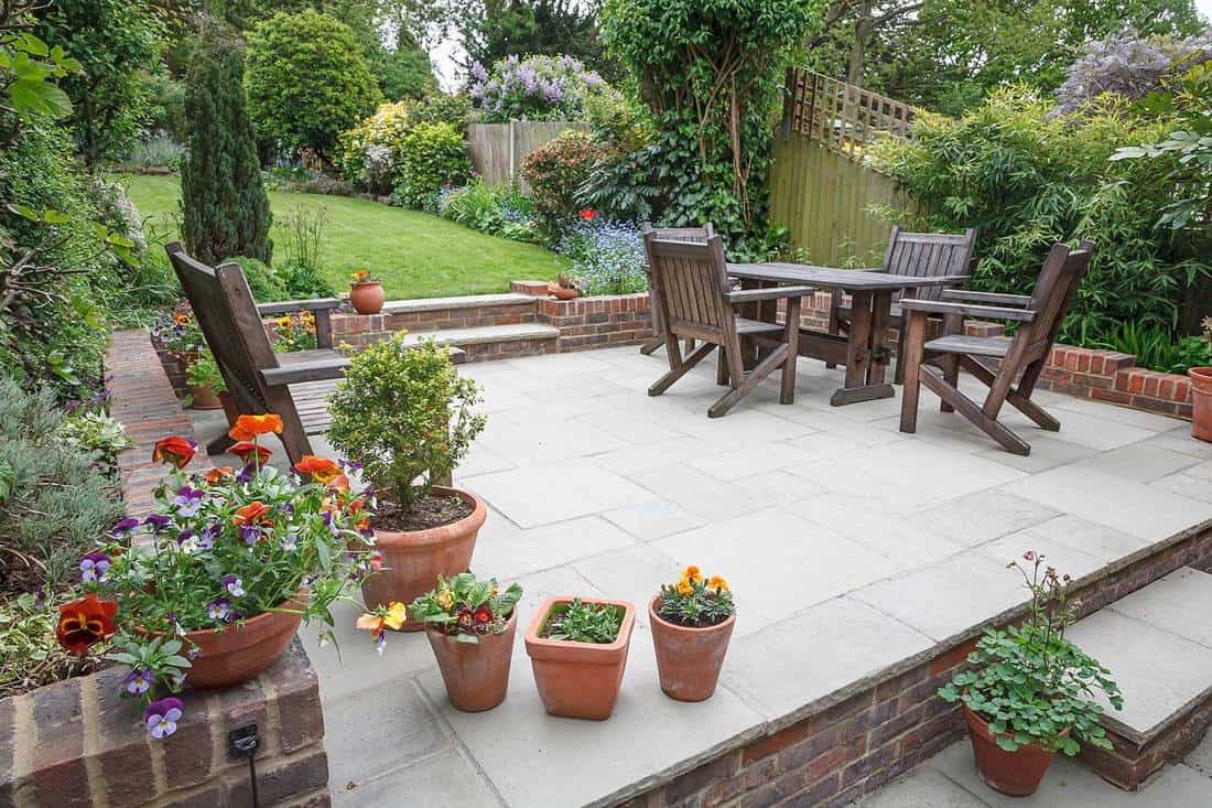 Hard landscaping of a new luxury stone patio and garden of an English home