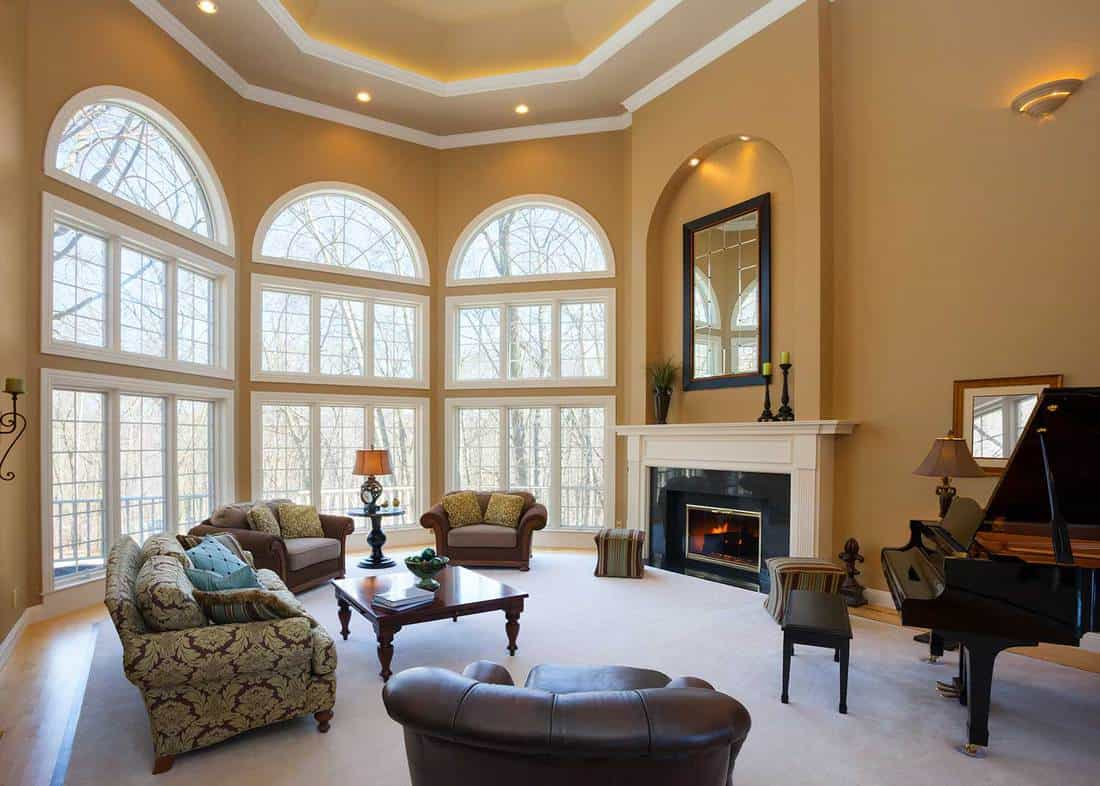 Home great room with vaulted ceiling and grand piano