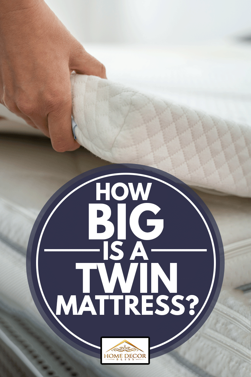 Twin Mattress Topper Being Laid On Top Of The Bed,How Big Is A Twin Mattress?