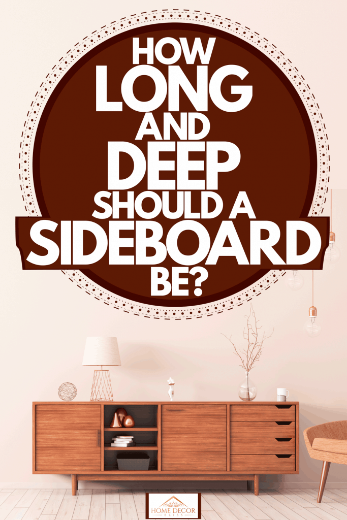 A wooden sideboard with lamps and a small chair on the side with dangling lamps, How Long And Deep Should A Sideboard Be?