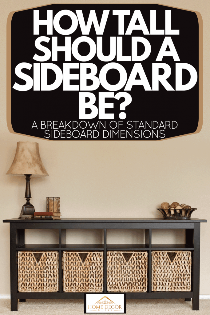A sideboard with lamp on the top inside a carpeted flooring living room, How Tall Should A Sideboard Be? [A Breakdown Of Standard Sideboard Dimensions]