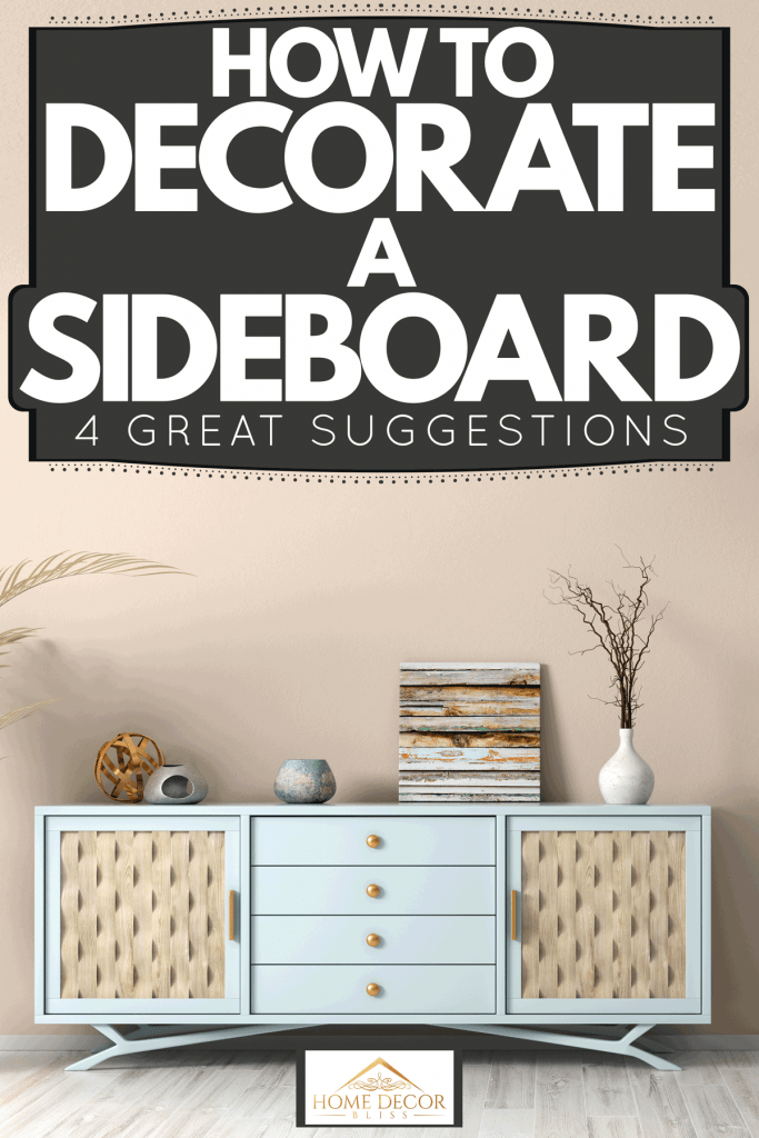 A blue wooden sideboard with a withered palm plant on the side, How To Decorate A Sideboard [4 Great Suggestions]