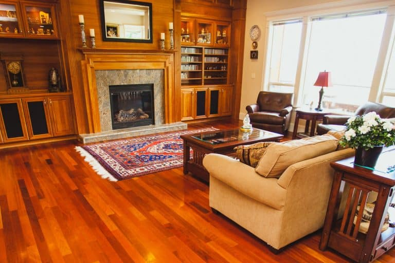Image of a luxury home with cherry hardwood floors, fire place, mantle, and furnishings, What Furniture Goes With Cherry Wood Floors?