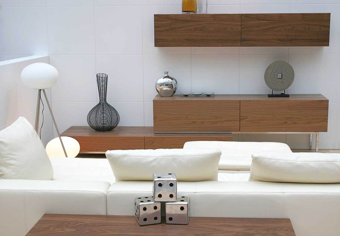 Interior living room with white sofa and tiled walls